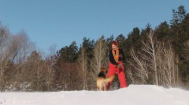 Beauty woman with dog in winter — Stock Video
