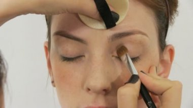 Beauty woman having her face made up by stylist — Stockvideo
