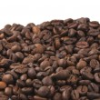 Brown roasted coffee beans isolated - Stock Photo