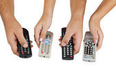 TV remote controls in their hands — Foto Stock