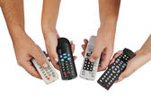 TV remote controls in their hands — Stok fotoğraf