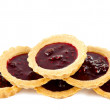 Tasty tartlets with raspberry jam isolated  — Stock Photo