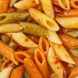 Penne rigate pasta with tomato sauce. background - Lizenzfreies Foto