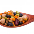 Collection of beans, legumes, peas, lentils on wooden spoons — Stock Photo