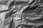 Crumpled black paper — Stock Photo