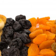 Prunes, figs, dried apricots isolated on white background - Stock Photo