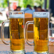 Two beer mugs close-up — Stockfoto