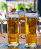 Two beer mugs close-up — Stock Photo