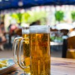 Two beer mugs close-up — Stock Photo #25449331