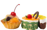 Cakes with fruit isolated — Stock Photo