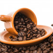 Coffee beans with a cup of coffee isolated  — Stock Photo