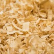 Background of wood shavings — Stock Photo #30625545