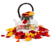Kettle in rose petals isolated — Stock Photo