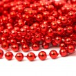 Christmas garland made from small red beads. — Stock Photo