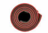 Red yoga mat nice for exercise at home or gym — Stock Photo