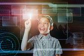 Boy touch virtual button in web inteface — Stock Photo