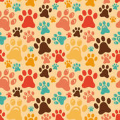 Vector seamless pattern with animal paws — Stock Vector