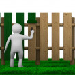 Stock Photo: Man paints fence on white background. Isolated 3D image