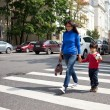 Mother and son are on a pedestrian crossing in the city — Stock Photo