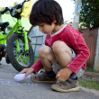 Boy  drawing with chalk on asphalt — Stok fotoğraf