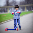 Boy with scooter — Stock Photo #16831477