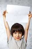 Enthusiastic boy with placard — Stock Photo