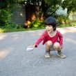 Boy drawing on asphalt — Stock Photo #18964337