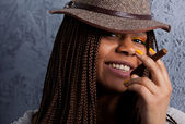 Portrait of a black girl with a cigar — Stock Photo