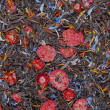 Black tea with dried berries, textura - Stock Photo