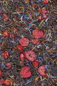 Black tea with dried berries, textura — Stock Photo