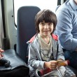Child in a public transport - Stockfoto