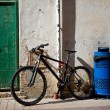 Old bicycle near the ancient walls — Stock Photo