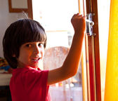 Boy opens the door of a new home — Stock Photo