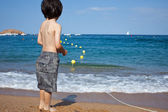 Boy looking at the blue sea — Stock Photo