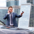 Businessman near a car — Stock Photo
