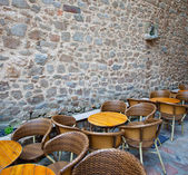 Summer cafe near the ancient stone wall — Stock Photo