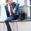 Businessman near office towers — Stock Photo