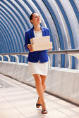 Happy businesswoman with boxes — Stock Photo