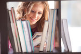 Student studying in the library — Stock Photo
