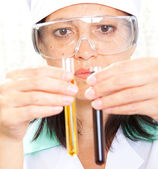 Scientist filling test tubes — Stock Photo