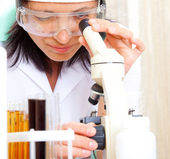 Scientist looking into microscope — Foto Stock