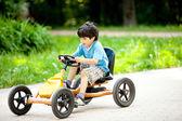 Boy rides a velomobile — Stock Photo