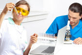 Doctor examines a test tube — Stock Photo