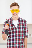 Smiling builder with a drill — Stock Photo