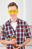Repairman with a drill — Stock Photo