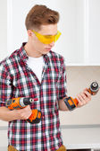 Smiling repairman with a drill — Stock Photo