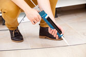 Worker repairing the floor — Stock Photo