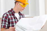 Builder with repair plan — Foto Stock