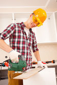 Worker works jigsaw — Stock Photo