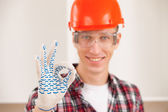 Master making a perfect gesture with his gloved hand — Stockfoto